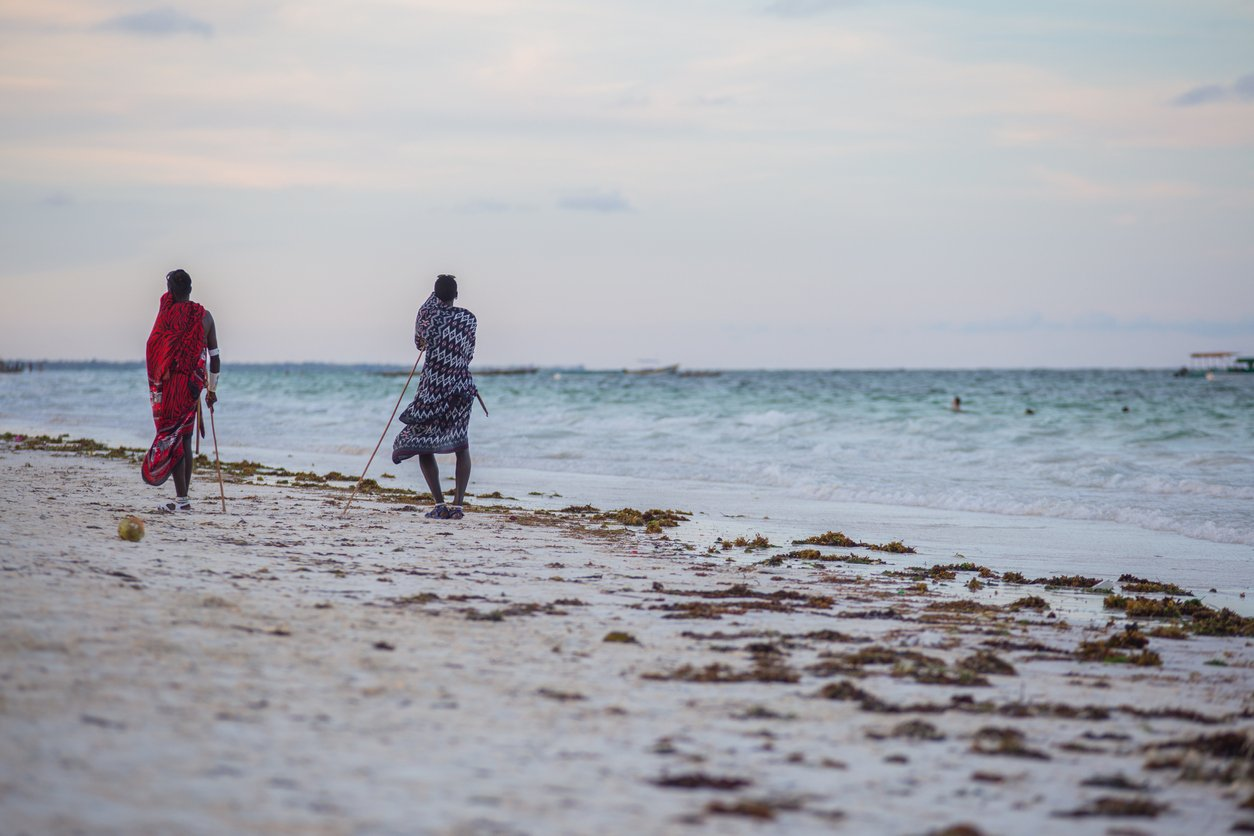 The beach in Zanzibar, Tanzania and the printed textile clothing.